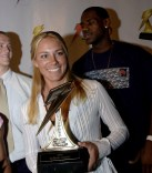 Lisa Dodd holding the trophy for being named the Gatorade National and California State High School Softball Player of the Year, 2003